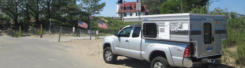 four-wheel-camper-fleet-light-house-beach-toyota-tacoma-camping